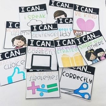 """Student goal setting cards scattered across table. Various """"I Can... statements printed on cards."""