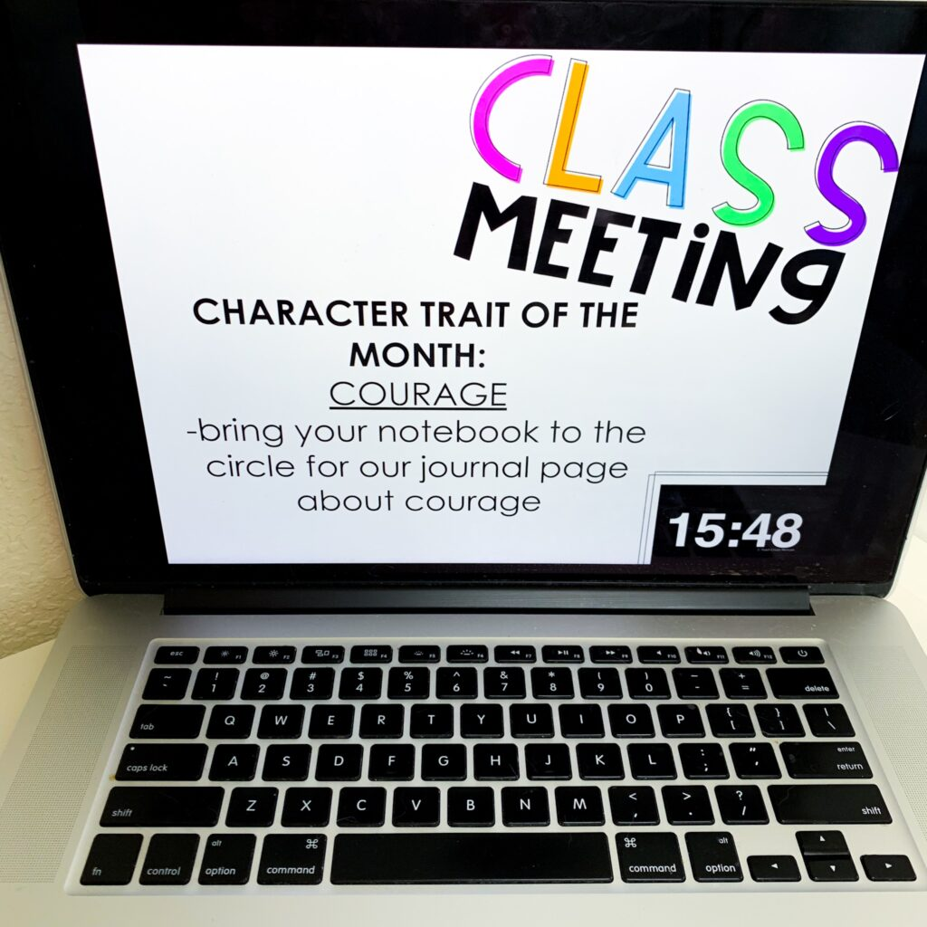 Picture of an open laptop displaying a Class Meeting slide