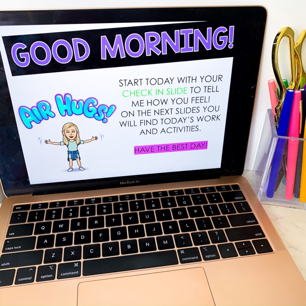 Open laptop displaying a morning greeting with a Bitmoji